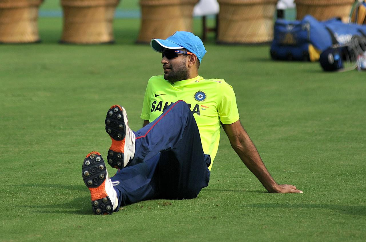 India A cricketer Irfan Pathan watches during a training session at the Cricket Club of India (CCI) in Mumbai on October 29, 2012.  The England cricket team, who are to play a four Test series against India from November 15, will play a three day practice match against India A.  AFP PHOTO/ PAL PILLAI        (Photo credit should read PAL PILLAI/AFP/Getty Images)