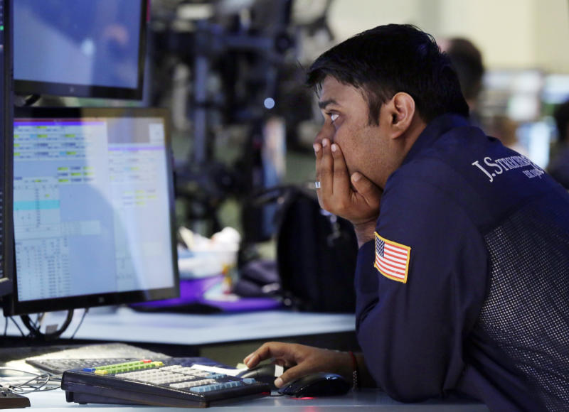 Specialist Niral Doshi works at his post on the floor of the New York Stock Exchange Monday, June 17, 2013. Stocks were up Monday because investors think Fed leaders will determine that the economy isn't recovering fast enough. (AP Photo/Richard Drew)
