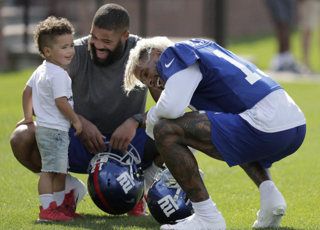 Odell Beckham, all smiles . (AP Photo/Julio Cortez)