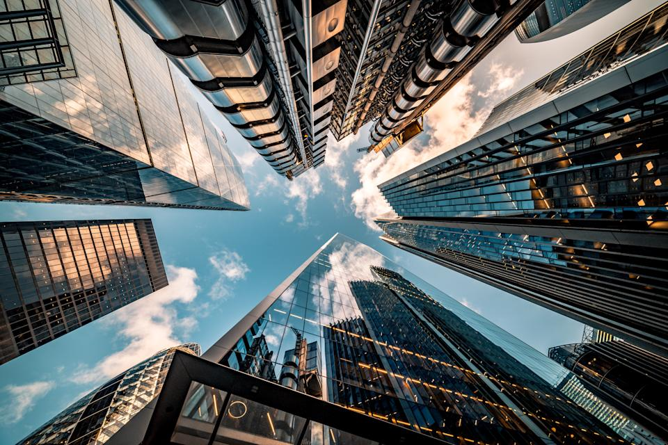 Highly detailed abstract wide angle view up towards the sky in the financial district of London City. Photo: Getty