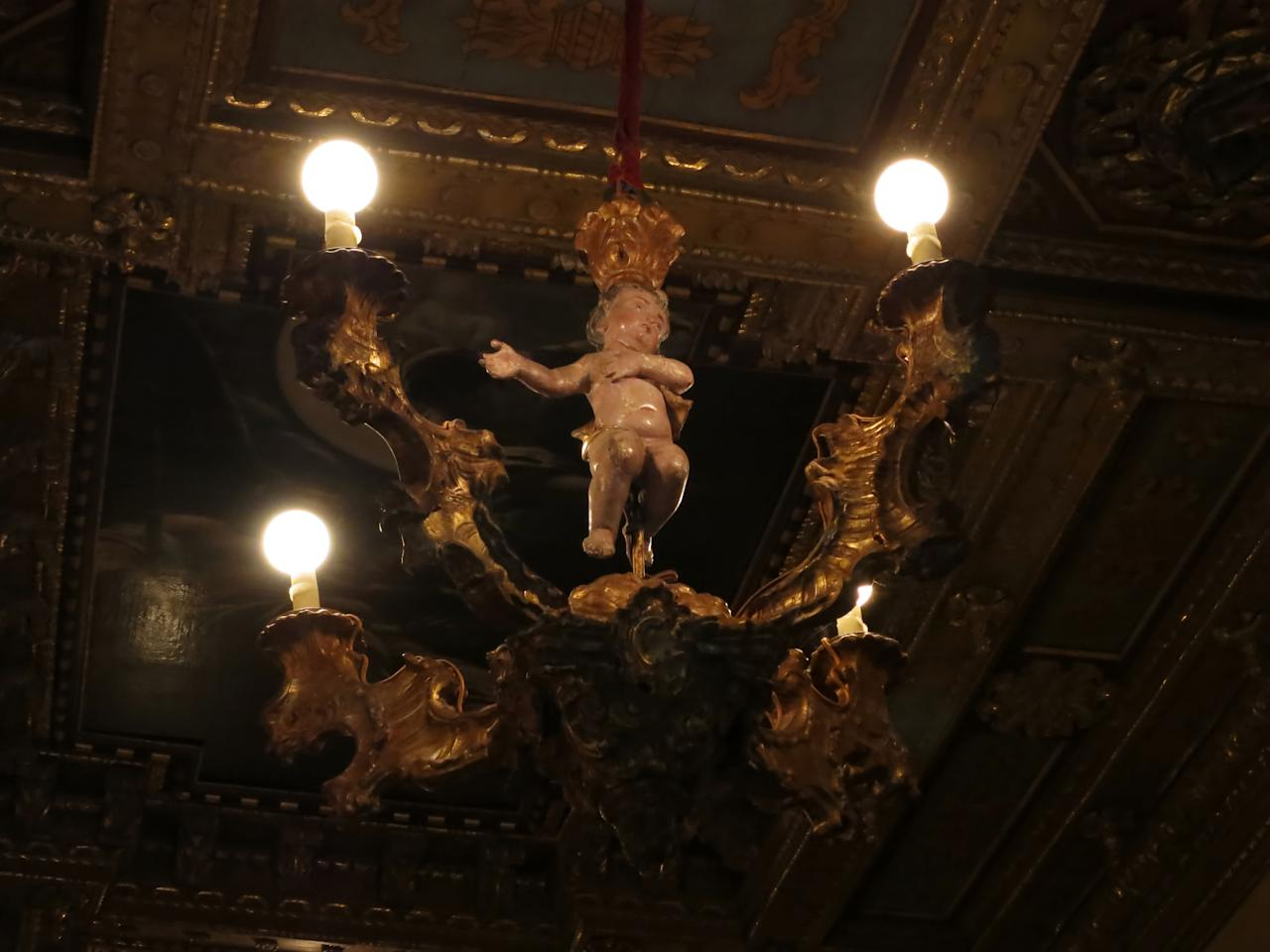 This Aug. 30, 2013 photo shows a lighting fixture hanging in The Hearst Castle, the 165-room estate of newspaper publisher William Randolph Hearst, in San Simeon, Calif. (AP Photo/Jim MacMillan)