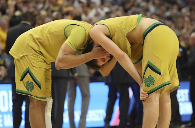 <p>Notre Dame forward Austin Torres, left, and Matt Ryan, right, react after their 83-71 loss to West Virginia in a second-round men's college basketball game in the NCAA Tournament, Saturday, March 18, 2017, in Buffalo, N.Y. (AP Photo/Bill Wippert) </p>