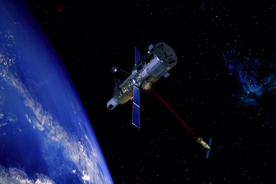 Space based laser attacking reconnaissance satellite