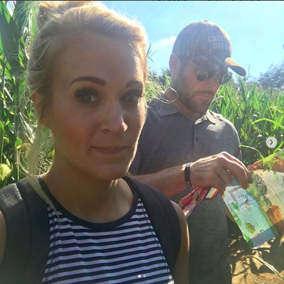 "<p>""Got lost in a sweet corn maze today at #luckyladdfarms,"" shared the singer, who posted this cute pic with her hockey hubby, Mike Fisher, getting into the Halloween spirit. ""Fortunately, @mfisher1212 had a map and saved us (or, we cheated and cut through the corn to get to the parking lot). Also saw lots of cute animals and got some pumpkins or the porch!""<br />(Photo: <a rel=""nofollow"" href=""https://www.instagram.com/p/BZkKUnClPJ9/?taken-by=carrieunderwood"">Carrie Underwood via Instagram</a>) </p>"