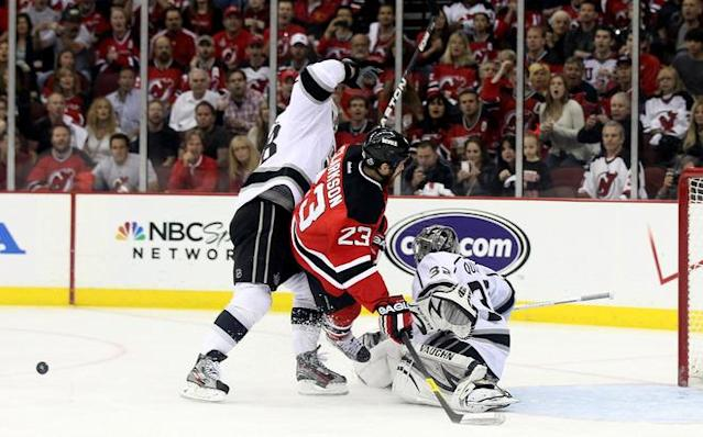 NEWARK, NJ - JUNE 02: David Clarkson #23 of the New Jersey Devils collides with Jonathan Quick #32 and Jarret Stoll #28 of the Los Angeles Kings during Game Two of the 2012 NHL Stanley Cup Final at the Prudential Center on June 2, 2012 in Newark, New Jersey. (Photo by Elsa/Getty Images)