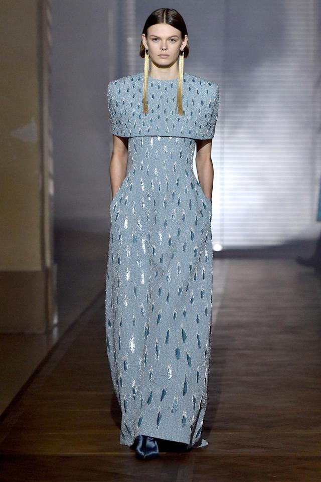 <p>Model wears a blue- and silver-embellished gown with long gold tassel earrings from the Givenchy SS18 Haute Couture show. (Photo: Getty Images) </p>