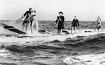 <p>Proof that couples have been attempting unique and quirky weddings for decades: This couple seals the deal with a kiss on a surfboard on December 3, 1932, just off Catalina Island, California. </p>