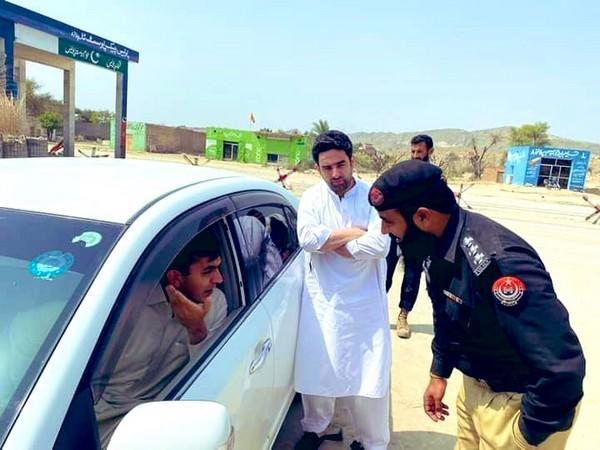 Member of the National Assembly (MNA) Mohsin Dawar being stopped by the Pakistan police. (Photo Credit: Bashir Ahmad Gwakh)
