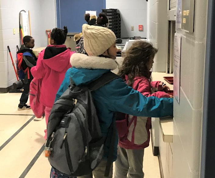 Laura B. Anderson students line up for breakfast in the school's gym at 7:30 a.m., before classes start, on Dec. 16, 2019.