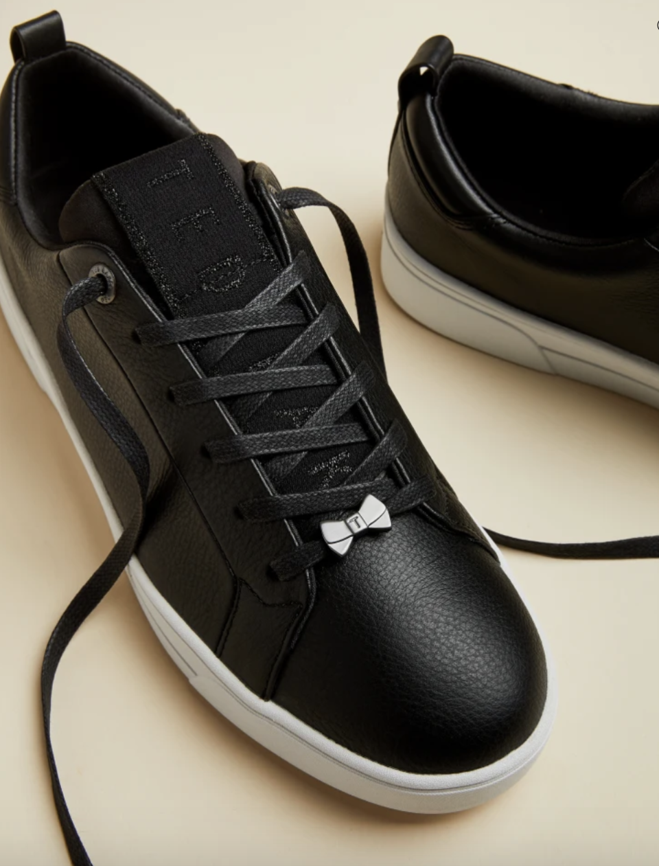 Branded leather trainers, £71 (was £119). PHOTO: Ted Baker