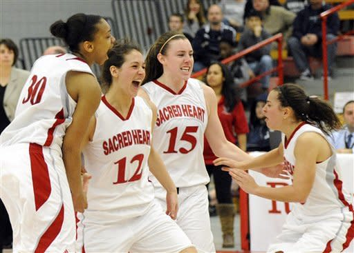 Sacred Heart's players celebrate after their 58-48 victory over Monmouth in the NEC championship final women's basketball game in Fairfield, Conn., Sunday, March 11, 2012. (AP Photo/Fred Beckham)