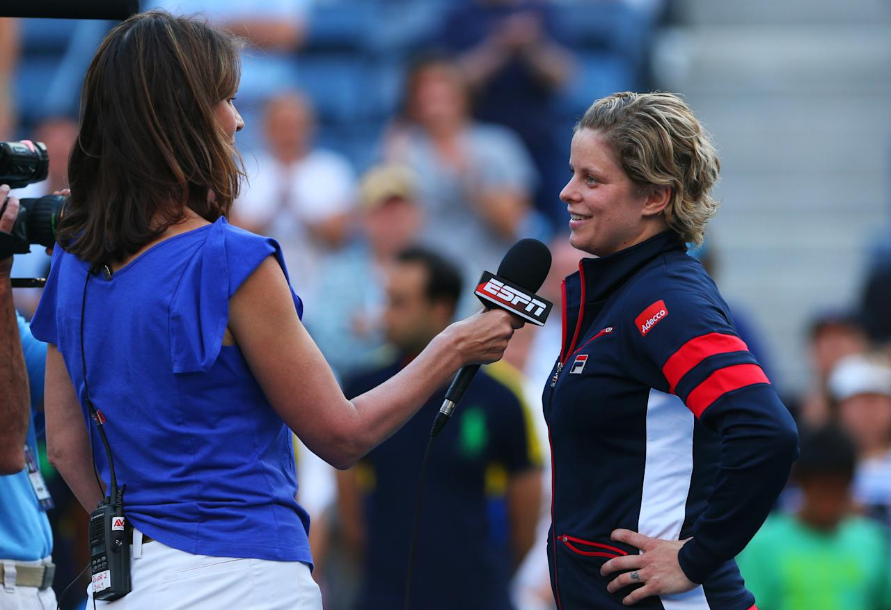 NEW YORK, NY - AUGUST 29:  Kim Clijsters of Belgium is interviewed following her defeat to Laura Robson of Great Britain after their women's singles second round match on Day Three of the 2012 US Open at USTA Billie Jean King National Tennis Center on August 29, 2012 in the Flushing neigborhood of the Queens borough of New York City.  (Photo by Cameron Spencer/Getty Images)