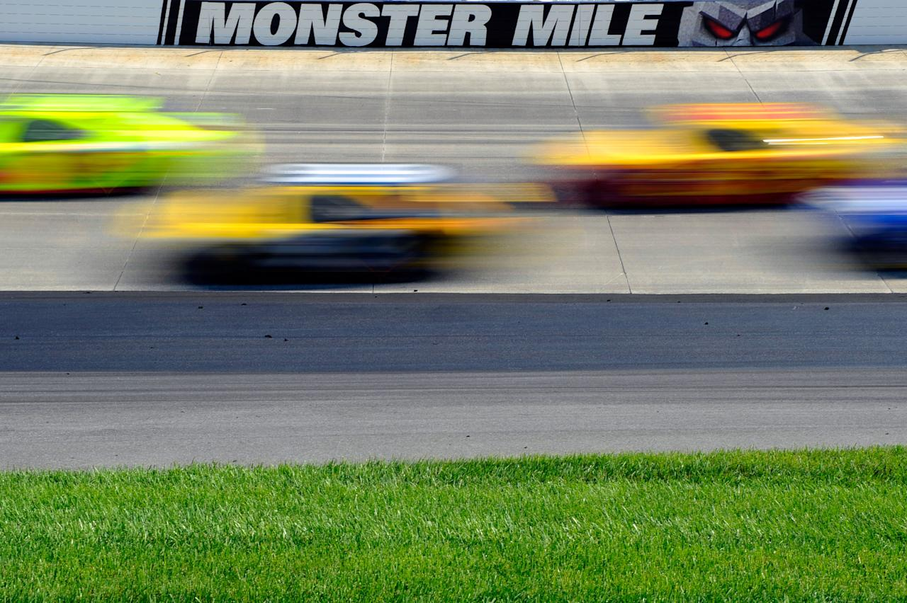 DOVER, DE - JUNE 03:  Cars race during the NASCAR Sprint Cup Series FedEx 400 benefiting Autism Speaks at Dover International Speedway on June 3, 2012 in Dover, Delaware.  (Photo by John Harrelson/Getty Images for NASCAR)