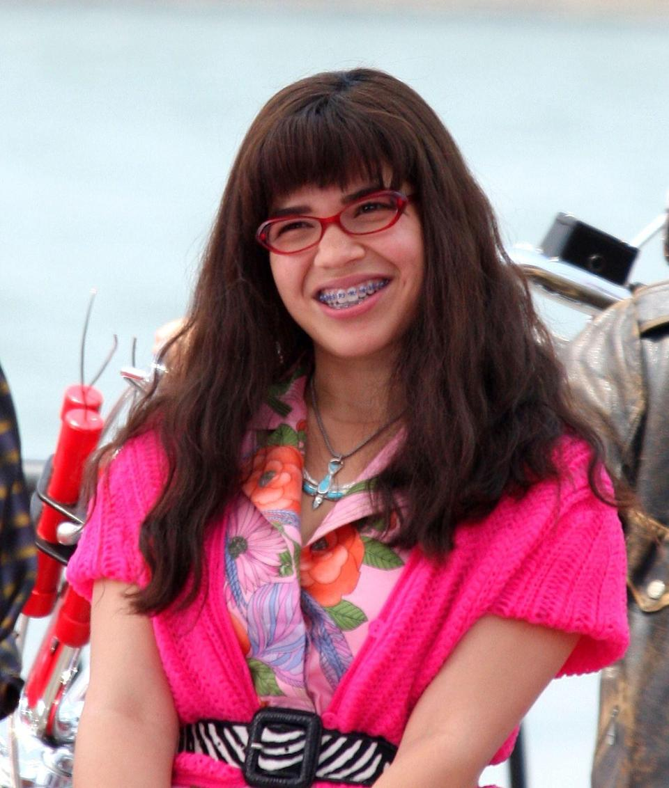 """<p>Unlike her character on <em>Ugly Betty</em>, America Ferrera didn't have braces, but she did wear a retainer for a while. To shoot the pilot, the creators tossed around the idea of getting real braces instead of the retainers she wore on the show. """"I was just terrified, but I was going to do it,"""" <a href=""""https://www.npr.org/transcripts/16329495"""" rel=""""nofollow noopener"""" target=""""_blank"""" data-ylk=""""slk:America said"""" class=""""link rapid-noclick-resp"""">America said</a>. """"They're like, this is just for the pilot. And if it gets picked up, then we'll find another alternative. So I was literally going to get braces augmented to my teeth for the pilot.""""</p>"""