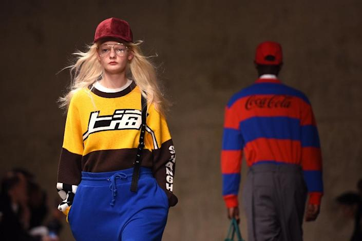 Models on the catwalk during the 1980s-themed show from Chinese label Peacebird (AFP Photo/TIMOTHY A. CLARY)