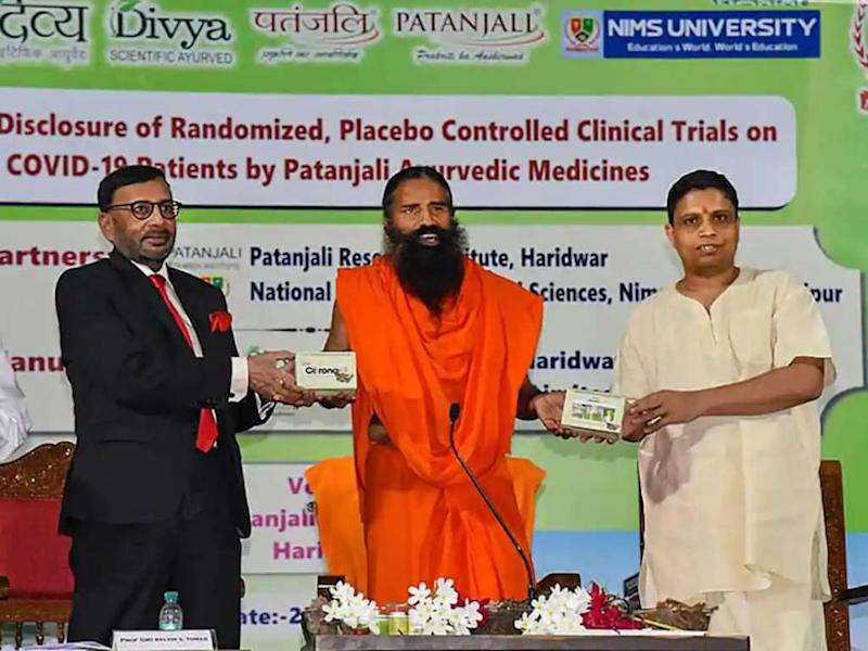 Founder Baba Ramdev and CEO Acharya Balkrishna of Patanjali launch an Ayurvedic medicine kit that they claimed can treat coronavirus patients within seven days. Image:@PypAyurved/Twitter