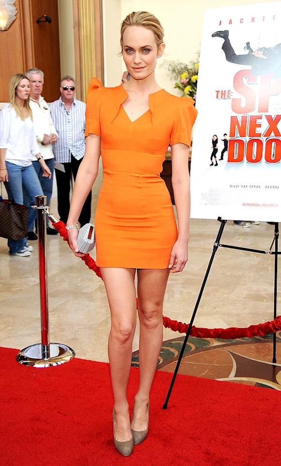 "But Kim wasn't the only hottie heating things up in LA this week. Model-turned-actress Amber Valleta was a tangerine dream at the ""Spy Next Door"" premiere in a ravishing RM by Roland Mouret dress. Frazer Harrison/<a href=""http://www.gettyimages.com/"" target=""new"">GettyImages.com</a> - January 9, 2010"