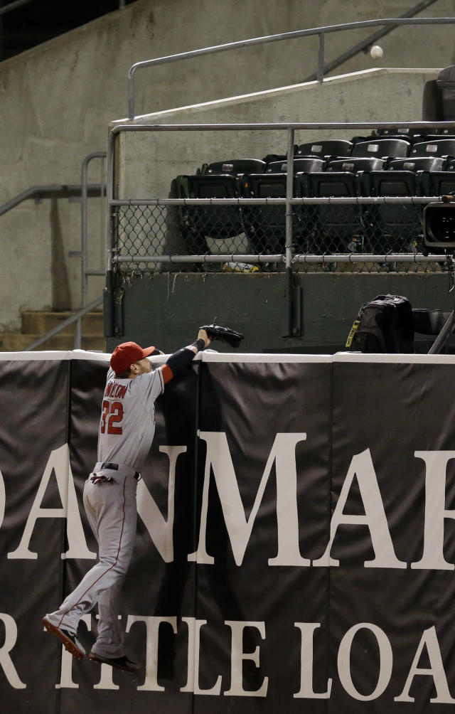 Los Angeles Angels right fielder Josh Hamilton watches a game winning two-run home run from Oakland Athletics' Brandon Moss during the nineteenth inning of a baseball game on Tuesday, April 30, 2013 in Oakland. Calif. Oakland won 10-8. (AP Photo/Marcio Jose Sanchez)