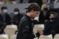 Austria's Dominic Thiem clenches his fist after scoring a point against France's Hugo Gaston in the fourth round match of the French Open tennis tournament at the Roland Garros stadium in Paris, France, Sunday, Oct. 4, 2020. (AP Photo/Alessandra Tarantino)
