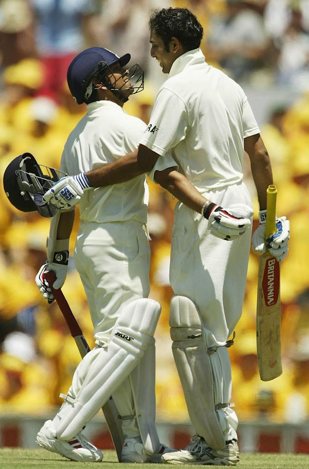 SYDNEY, AUSTRALIA - JANUARY 3:  VVS Laxman of India is congratulated on his century by teammate Sachin Tendulkar during day two of the 4th Test between Australia and India at the SCG on January 3, 2004 in Sydney, Australia.  (Photo by Hamish Blair/Getty Images)