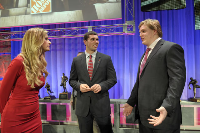 Alabama's Barrett Jones, right, talks with Stanford's Andrew Luck, center, and ESPN's Erin Andrews after the College Football Awards ceremony in Lake Buena Vista, Fla., Thursday, Dec. 8, 2011.(AP Photo/Phelan M. Ebenhack)