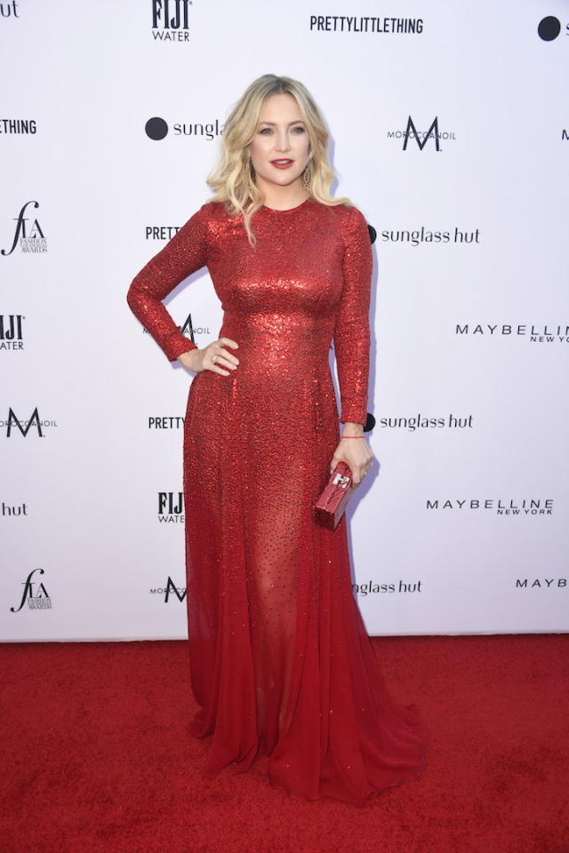 <p>Fellow celebrity Kate Hudson also proved red Oscar de la Renta is the fashion failsafe of the season in a sequinned number and matching clutch. A lick of lipstick further cemented the look. <em>[Photo: Getty]</em> </p>