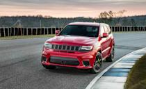 """<p>When it was introduced in 2018, the <a href=""""https://www.caranddriver.com/jeep/grand-cherokee-trackhawk"""" rel=""""nofollow noopener"""" target=""""_blank"""" data-ylk=""""slk:Jeep Grand Cherokee Trackhawk"""" class=""""link rapid-noclick-resp"""">Jeep Grand Cherokee Trackhawk</a> was the most powerful SUV ever made. Things aren't much different today. With a base price of $89,940, it's also one of the least expensive SUVs on this list. Underneath its vented hood is a supercharged 6.2-liter Hemi V-8 bolted to an eight-speed automatic transmission. And it's still the same iron-block, pushrod V-8 with just two valves per cylinder that has been powering the Dodge Charger and Challenger Hellcats since 2015. In the five-passenger Grand Cherokee, it's rated 707 horsepower and 645 lb-ft of torque, just as it is in the Charger. That's considerably more rip than you get in the 475-hp Grand Cherokee SRT. <a href=""""https://www.caranddriver.com/reviews/a15078588/2018-jeep-grand-cherokee-trackhawk-full-test-review/"""" rel=""""nofollow noopener"""" target=""""_blank"""" data-ylk=""""slk:In our testing"""" class=""""link rapid-noclick-resp"""">In our testing</a>, the Trackhawk hit 60 mph in 3.4 seconds. Jeep claims a top speed of 180 mph. </p><p><a class=""""link rapid-noclick-resp"""" href=""""https://www.caranddriver.com/jeep/grand-cherokee-trackhawk/specs"""" rel=""""nofollow noopener"""" target=""""_blank"""" data-ylk=""""slk:MORE GRAND CHEROKEE TRACKHAWK SPECS"""">MORE GRAND CHEROKEE TRACKHAWK SPECS</a><br></p>"""