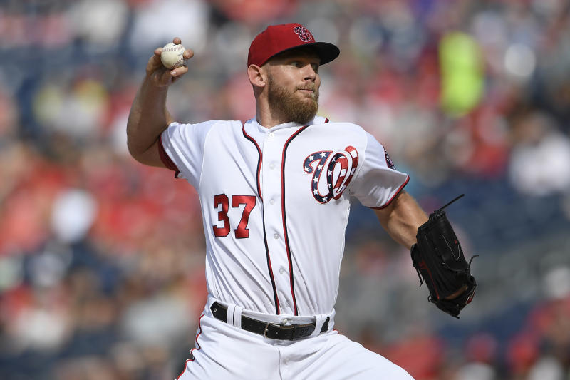 Washington Nationals starting pitcher Stephen Strasburg delivers a pitch during the third inning of a baseball game against the Arizona Diamondbacks, Saturday, June 15, 2019, in Washington. (AP Photo/Nick Wass)