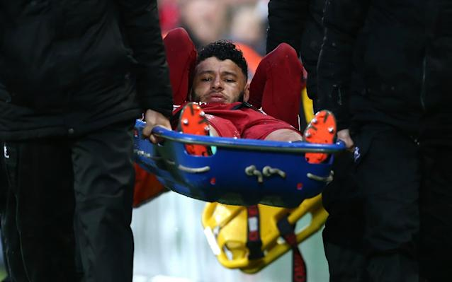 "Alex Oxlade-Chamberlain is expected to miss the entire Premier League season as he continues his rehabilitation from a serious knee injury. The Liverpool midfielder sustained multiple ligament damage in the Champions League semi-final against Roma in April. He was injured after a sliding tackle on Roma wing-back Aleksandar Kolarov and underwent surgery. Having refused to offer a timescale for recovery when the injury was sustained, Liverpool manager Jurgen Klopp has now confirmed he is prepared for the 24-year-old's lengthy absence, suggesting any competitive return during the 2018-19 season would be a ""bonus"". It is a shattering revelation for a player who missed the Champions League final and World Cup. Klopp said Oxlade-Chamberlain always knew the severity of the injury but wanted it kept private initially to avoid a downbeat mood at the climax of last season when his team-mates were competing for the Champions League. ""It is typical of Ox that he didn't want the news to overshadow the end of the season and, to be quite honest, we thought we could wait and tell people at an appropriate time,"" said Klopp. Oxlade-Chamberlain enjoyed a very promising first season at Anfield Credit: PA ""It feels like now is an appropriate time to tell people that, for Ox, this coming season will be about focusing on recovery and rehab. We have known this from pretty much the day after he got the injury and after the successful surgery, we were sure of it. There has been no change, no setback – it's exactly on the schedule we expected and planned for. The new information is that we're now giving more detail publicly. ""His surgery – which he had on the day of our second leg in Rome – has been completely successful and his recovery has started superbly well. But the truth of the matter is that we are preparing this season knowing he will not be with us on the pitch for competitive matches for the majority of it. If we do see him this season it will be a bonus."" Liverpool's transfer plans have been proceeding accordingly, Klopp's purchase of two midfielders – Naby Keita and Fabinho – and attacker Xherdan Shaqiri from Stoke City compensating for Oxlade-Chamberlain's absence. These are the players to fill the void left by Chamberlain. There are no plans to add another short-term replacement. Captain Jordan Henderson, James Milner, Adam Lallana and Georginio Wijnaldum ensure there are still plenty of midfield options. Klopp says the strength in depth makes it easier to ease Oxlade-Chamberlain back rather than rush his return. ""It is so important – because of how valuable and important he is to what we are looking to do here in the coming seasons – that the focus is on doing this right and not rushed,"" said Klopp. ""Ox is completely on board with this approach."" Oxlade-Chamberlain moved to Anfield from Arsenal last August for £35 million, and once settled made himself a crowd favourite – demonstrating the potential many felt unfulfilled at The Emirates. He struck two wonder goals against Manchester City in the Premier League and Champions League, and was certain to have started the final but for his injury. He would also most likely have been a starter for Gareth Southgate in Russia. At the time of his operation, Oxlade-Chamberlain spoke of his devastation as he was resigned to a prolonged spell on the sidelines. The Oxlade-Chamberlain disclosure balanced on otherwise encouraging day at Anfield with goalkeeper Alisson close to joining. Klopp will declare himself happy with Liverpool's transfer business, although he has not yet filled the No 10 jersey vacated by Philippe Coutinho last January. It is conceivable he will not do so in this window. Liverpool ended interest in Nabil Fekir before the World Cup having agreed a fee with Lyon, and despite several erroneous reports since have shown no inclination to revive the deal. Fekir's move broke down after a medical. Nothing has changed since, suggestions Liverpool wanted to restructure payments incorrect."