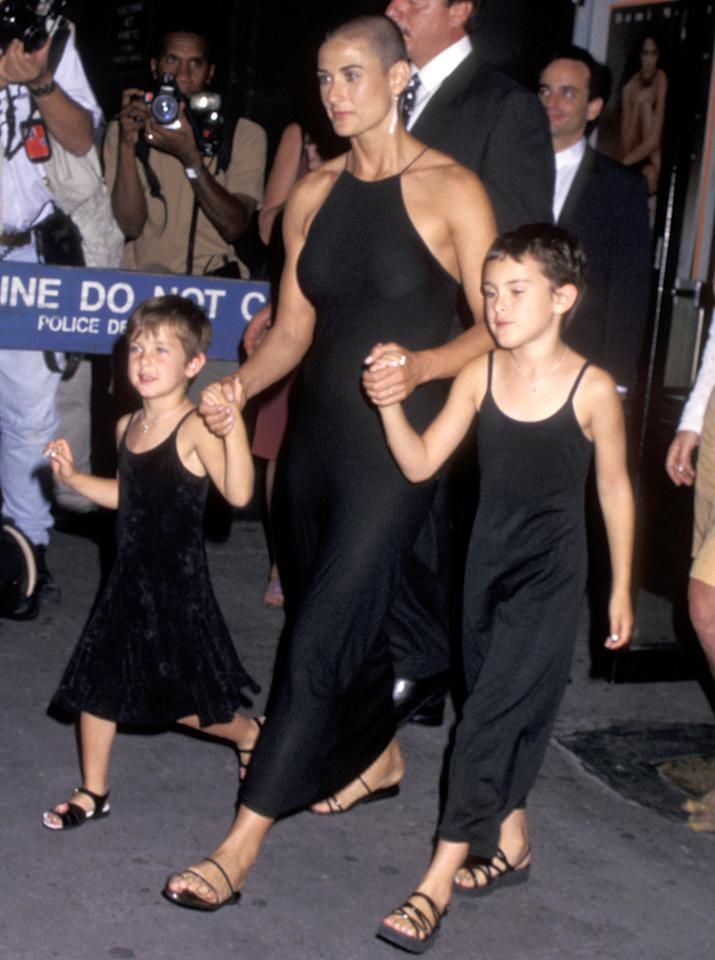<p>The two eldest Willis girls arrived at the Ziegfeld Theater in New York City with their mom for the premiere of her film <em>Striptease. </em>From the black tank top dresses, to the buzz cut hair, this was an exceptionally twinning moment for Moore and her daughters. </p>