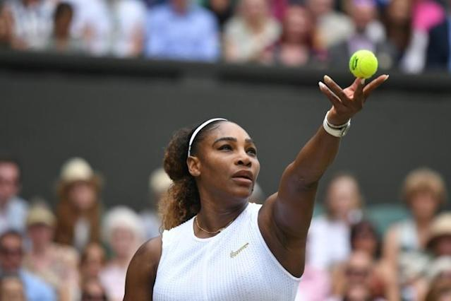 Serena Williams, here serving in her Wimbledon finals loss to Simona Halep, tops Forbes' list of sport's top women earners for a fourth straight year. (AFP Photo/Ben STANSALL)