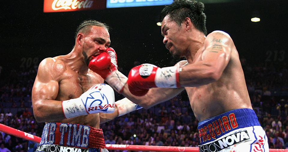 Filipino boxer Manny Pacquiao (R) slams a right to the face of US boxer Keith Thurman  during their WBA super world welterweight title fight at the MGM Grand Garden Arena on July 20, 2019 in Las Vegas, Nevada. - Pacquiao won a 12 round split decision. (Photo by John Gurzinski / AFP)        (Photo credit should read JOHN GURZINSKI/AFP/Getty Images)