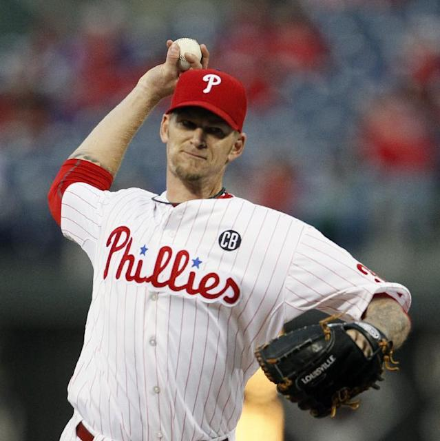 Philadelphia Phillies' A. J. Burnett throws during the first inning of a baseball game against the Miami Marlins, Friday, April 11, 2014, in Philadelphia. (AP Photo/Tom Mihalek)