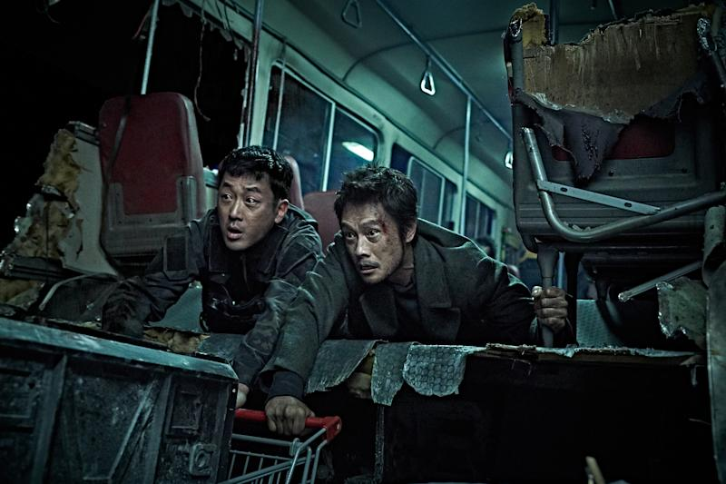 Ha Jung-woo (left) as Cho In-chang and Lee Byung-hun as Ri Jun-pyong in South Korean volcanic disaster movie Ashfall. (PHOTO: Encore Films)