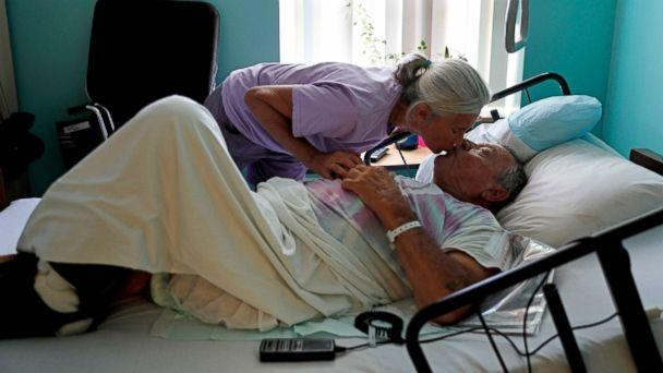 PHOTO: Marge Brown, 65, says goodbye to her father, George Brown, 90, before he is evacuated from a healthcare home in Morehead City, N.C., Sept. 12, 2018, as Hurricane Florence approaches the east coast. (David Goldman/AP)