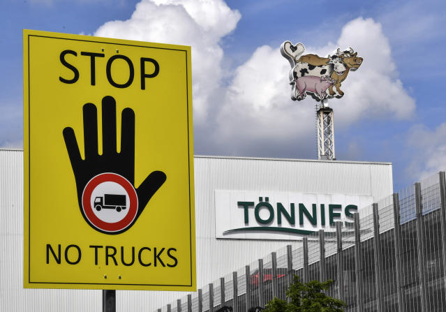 A fresh outbreak of COVID-19 cases has been traced to the Toennies meatpacking plant in Rheda-Wiedenbrueck, Germany. (Martin Meissner/AP)