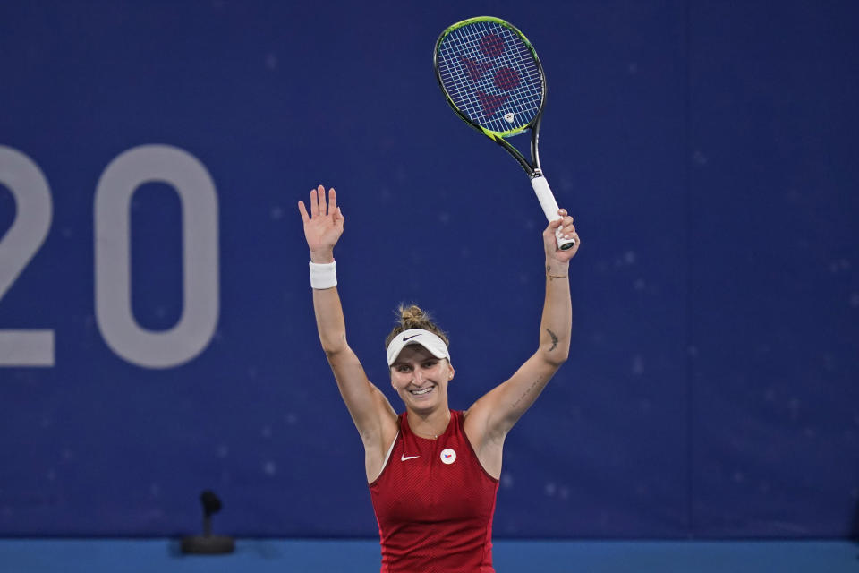 Marketa Vondrousova, of the Czech Republic, reacts after defeating Naomi Osaka, of Japan, during the third round of the tennis competition at the 2020 Summer Olympics, Tuesday, July 27, 2021, in Tokyo, Japan. (AP Photo/Seth Wenig)