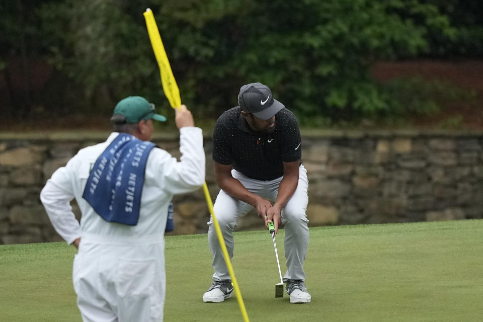 Tony Finau reacts after missing a birdie putt on the 11th hole during the third round of the Masters golf tournament on Saturday, April 10, 2021, in Augusta, Ga. (AP Photo/David J. Phillip)