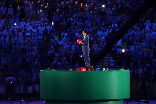 <p>Japanese Prime Minister Shinzo Abe appears from the pipe duirng the flag handover segment during the Closing Ceremony on Day 16 of the Rio 2016 Olympic Games at Maracana Stadium on August 21, 2016 in Rio de Janeiro, Brazil. (Photo by Patrick Smith/Getty Images) </p>