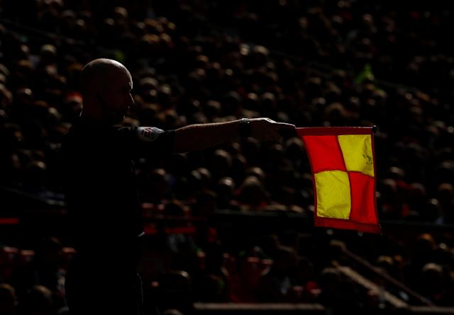 "Soccer Football - Premier League - Manchester United vs Watford - Old Trafford, Manchester, Britain - May 13, 2018 General view of an assistant referee Action Images via Reuters/Jason Cairnduff EDITORIAL USE ONLY. No use with unauthorized audio, video, data, fixture lists, club/league logos or ""live"" services. Online in-match use limited to 75 images, no video emulation. No use in betting, games or single club/league/player publications. Please contact your account representative for further details."
