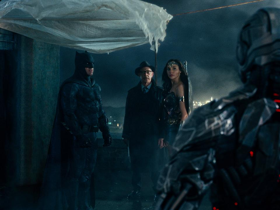 Batman (Ben Affleck), Jim Gordon (JK Simmons), Wonder Woman (Gal Gadot) facing Cyborg (Ray Fisher) in Zack Snyder's Justice League (Warner Bros)