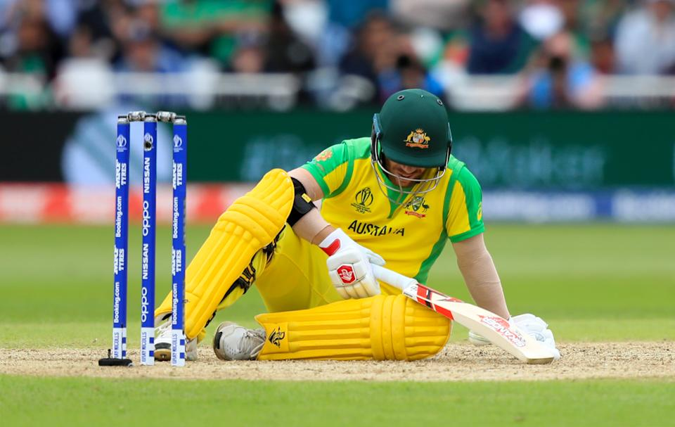 Australia's David Warner goes down after being hit by the ball during the ICC Cricket World Cup group stage match at Trent Bridge, Nottingham. (Photo by Simon Cooper/PA Images via Getty Images)
