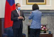 U.S. Health and Human Services Secretary Alex Azar, left, is greeted by Taiwan's President Tsai Ing-wen, right, during a meeting in Taipei, Taiwan Monday, Aug. 10, 2020. Azar met with Tsai on Monday during the highest-level visit by an American Cabinet official since the break in formal diplomatic ties between Washington and Taipei in 1979. (Pool Photo via AP Photo)