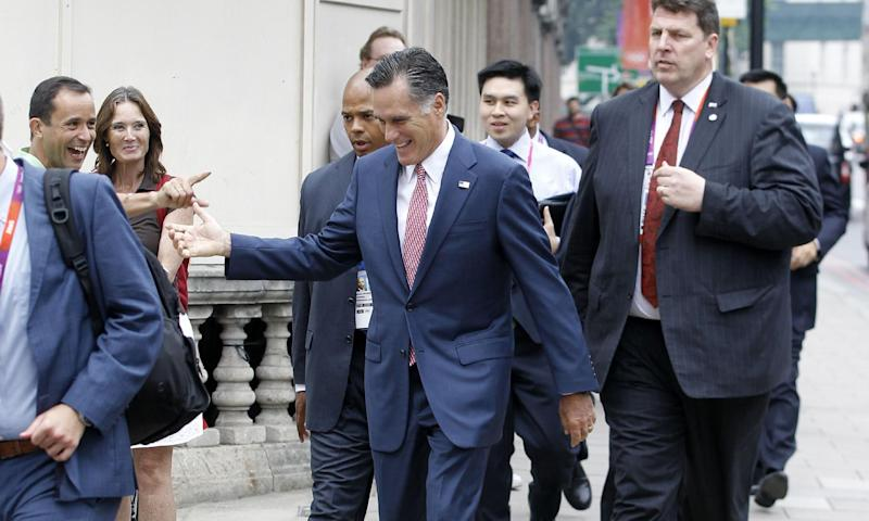 Avoiding a traffic jam, Republican presidential candidate, former Massachusetts Gov. Mitt Romney is recognized by bystander as he walks down Grosvenor Place to meet Ireland's Prime Minister Enda Kenny at the Embassy of Ireland in London, Friday, July 27, 2012. (AP Photo/Charles Dharapak)