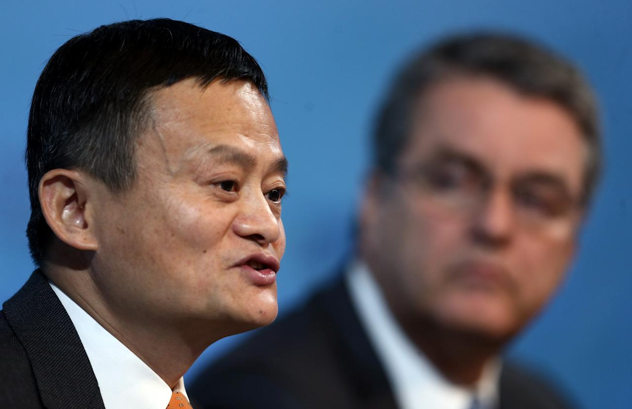Alibaba Group Executive Chairman Jack Ma speaks next to Director-General of the World Trade Organization Roberto Azevedo talk at the 11th WTO's ministerial conference in Buenos Aires, Argentina December 11, 2017. REUTERS/Marcos Brindicci