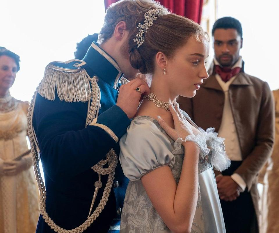BRIDGERTON (L to R) FREDDIE STROMA as PRINCE FRIEDERICH, PHOEBE DYNEVOR as DAPHNE BRIDGERTON and REGÉ-JEAN PAGE as SIMON BASSET in episode 104 of BRIDGERTON Cr. LIAM DANIEL/NETFLIX © 2020
