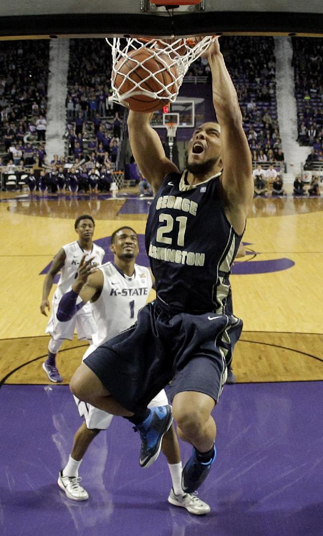George Washington's Kevin Larsen (21) gets past Kansas State's Shane Southwell (1) to dunk the ball during the first half of an NCAA college basketball game Tuesday, Dec. 31, 2013, in Manhattan, Kan. (AP Photo/Charlie Riedel)
