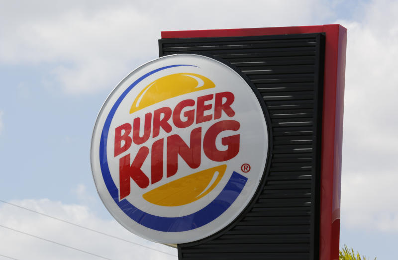 The sign on a Burger King restaurant is shown in Miami, Florida October 28, 2013. Picture taken October 28, 2013. REUTERS/Joe Skipper (UNITED STATES - Tags: BUSINESS LOGO)