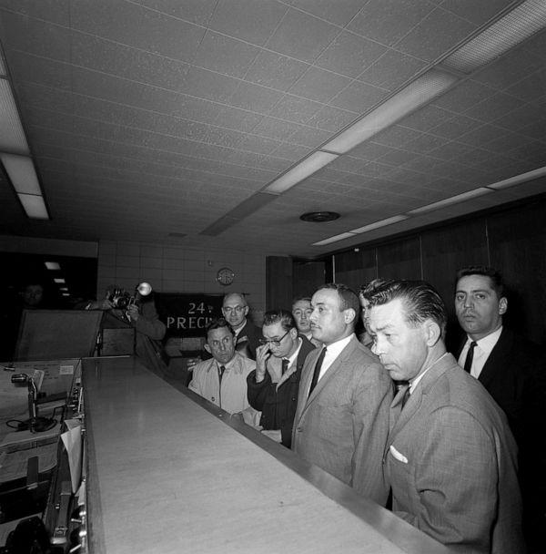 PHOTO: Thomas 15X Johnson, 30, center, arrives at the police station to be booked for the homicide of Malcolm X, March 3, 1965, in New York City. (Bettmann Archive/Getty Images, FILE)