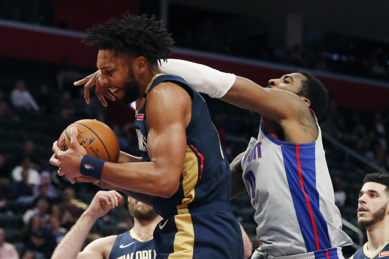 Detroit Pistons center Andre Drummond, right, reaches in as New Orleans Pelicans center Jahlil Okafor grabs a rebound during the first half of an NBA basketball game, Monday, Jan. 13, 2020, in Detroit. (AP Photo/Carlos Osorio)